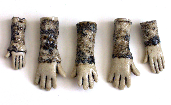 slipcast lace ceramic hands with iron oxide