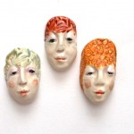 ceramic face beads painted with underglazes