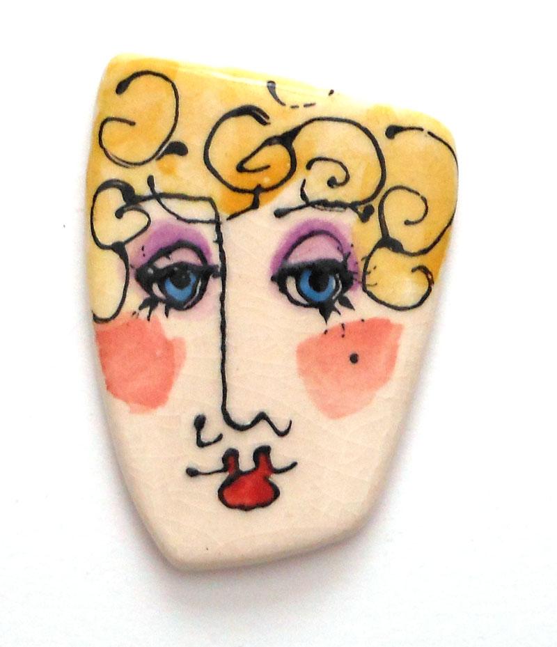 ceramic face painted with underglazes
