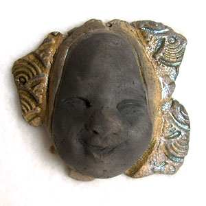 raku fired ceramic face