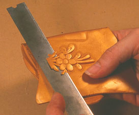 cutting off the raised surface of polymer clay