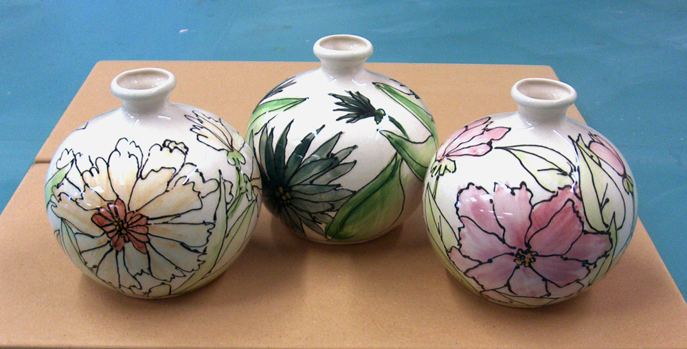 ceramic pots with painted flowers