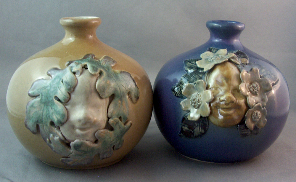 slipcast ceramic face vases