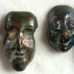 raku fired ceramic faces
