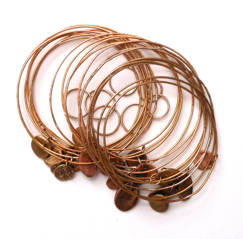 etched bronze bracelets and rings