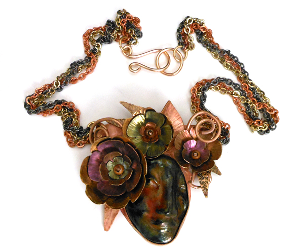 metal flowers and ceramic face necklace