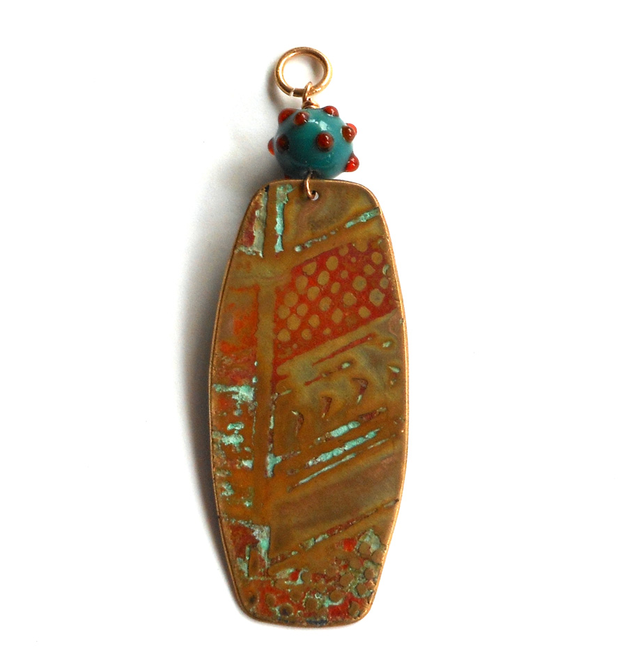 etched metal and glass pendant