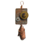 etched metal steampunk pendant with mehndi hand