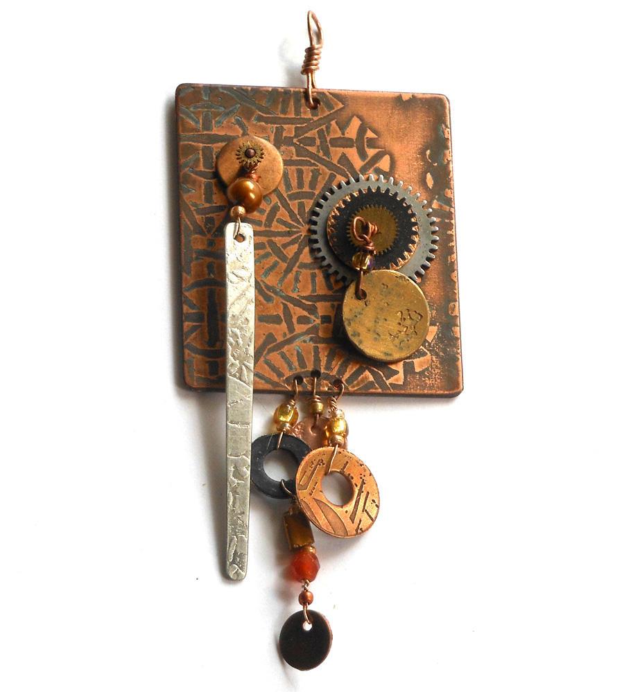 etched metal steampunk pendant