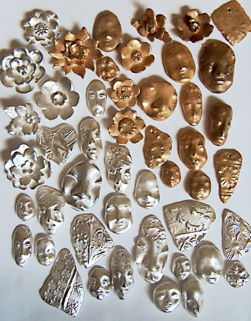 silver and bronze precious metal clay after polishing
