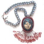 Laura Humenik face necklace made with polymer clay babushka bead