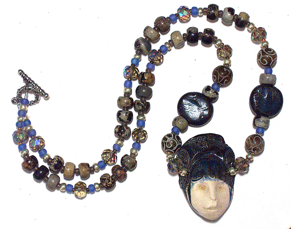 ceramic face ceramic and stone beads necklace