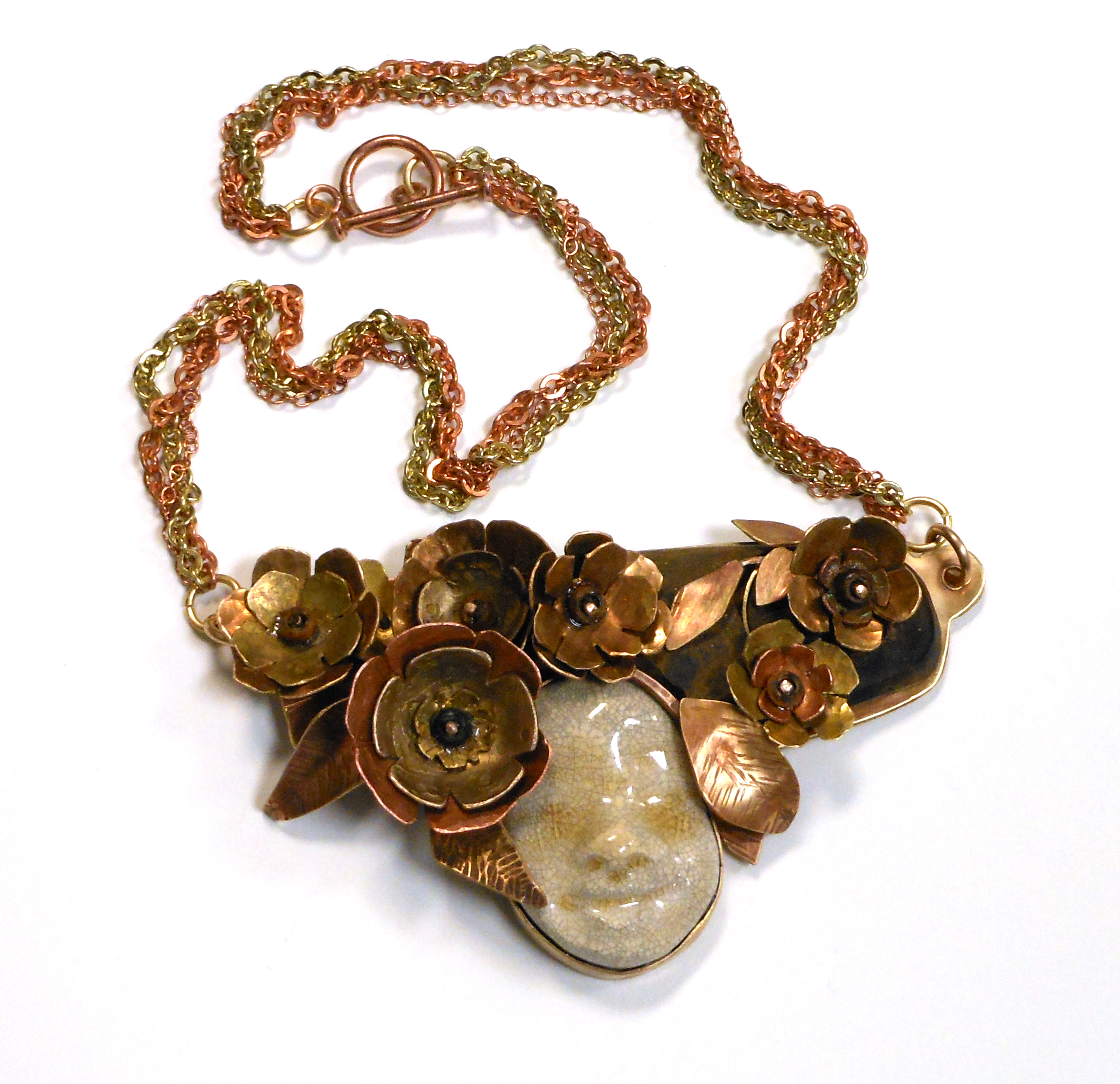 metal and ceramic necklace with fossilized wood