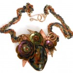 anodized titanium, copper and bronze flowers necklace with ceramic face