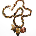 kumihimo necklace with metal masks