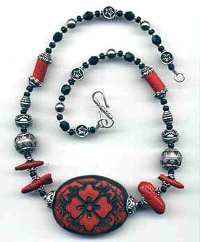 faux cinnabar and coral beads made with polymer clay
