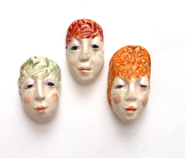 ceramic face beads with underglazes