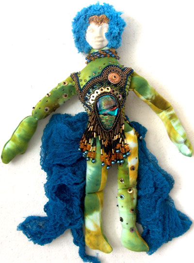 green tiedyed fabric and beads spirit doll with dichroic glass