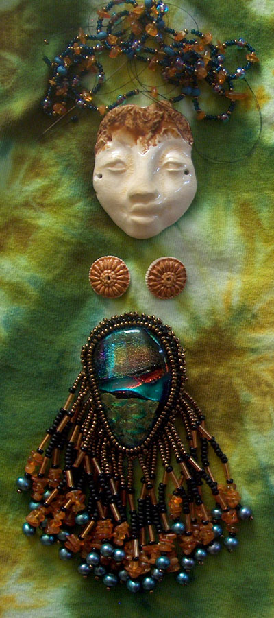 tie dyed cloth ceramic glass and beads for spirit doll