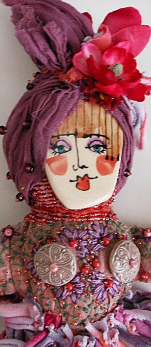 detail ceramic face spirit doll