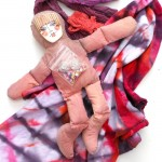 tiedyed cloth ribbons and ceramic face spirit doll