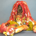 cloth beads and polymer clay face spirit doll