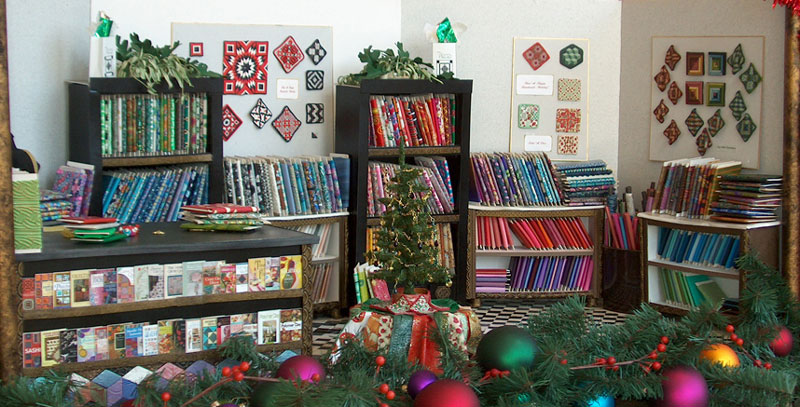 Christmas time at Pieces, a miniature quilt shop