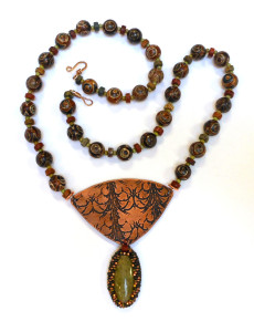 etched bronze and beadwork necklace